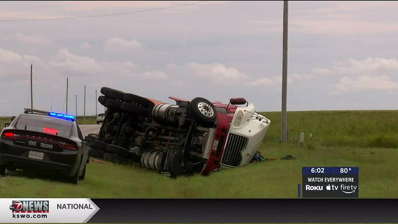 A semi-truck rolls over on its side in Lawton.