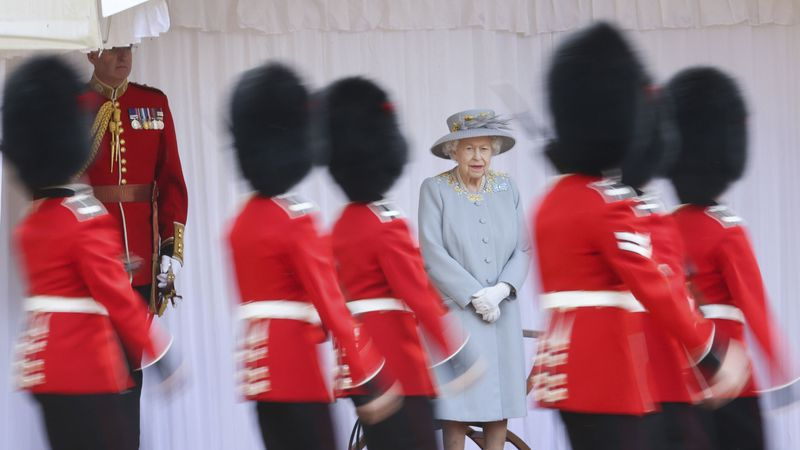 Britain's Queen Elizabeth II watches a ceremony to mark her official birthday at Windsor...