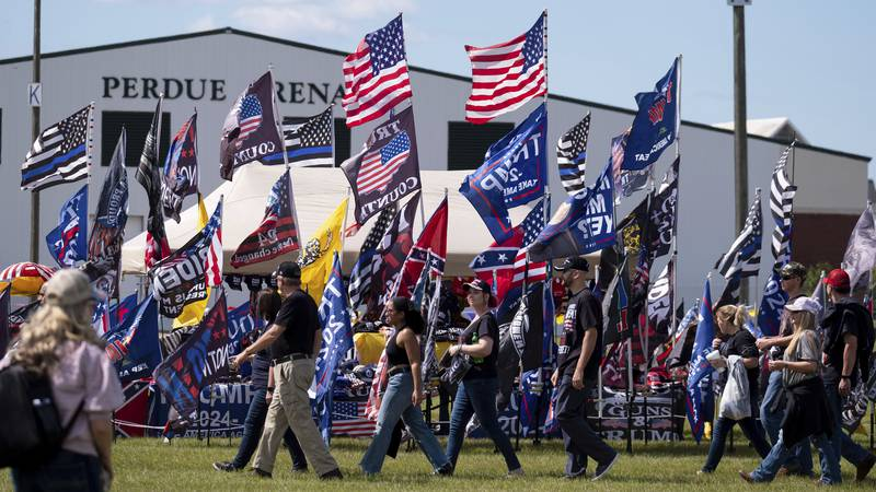 Supporters file into the Georgia National Fairgrounds in Perry, Ga., to attend former president...