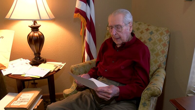 A photo of a WWII veteran asking for birthday cards for his 100th birthday went viral on social...