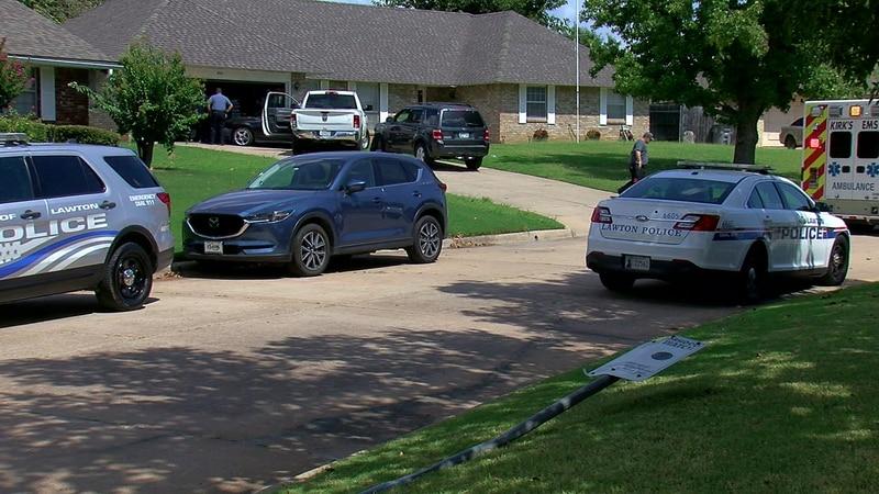 Lawton police arrest man after a car crash which hit a woman's home.