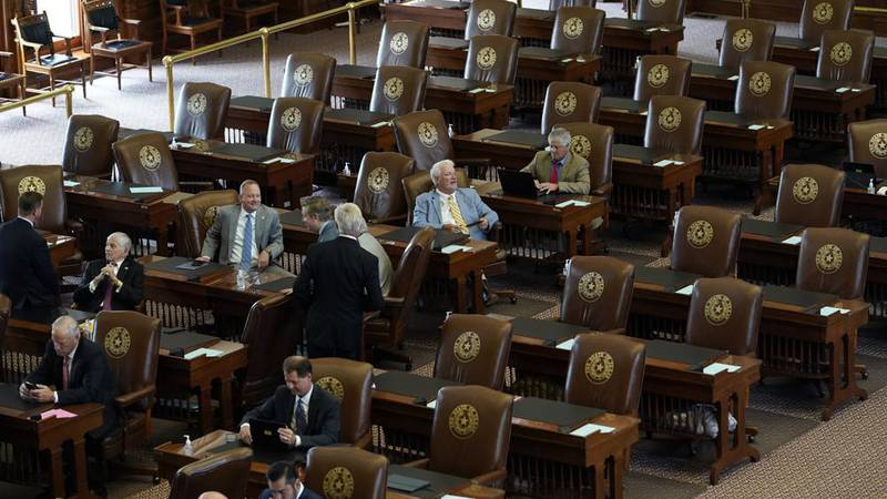 Empty seats are seen in the House Chamber at the Texas Capitol, Tuesday, July 13, 2021, in...