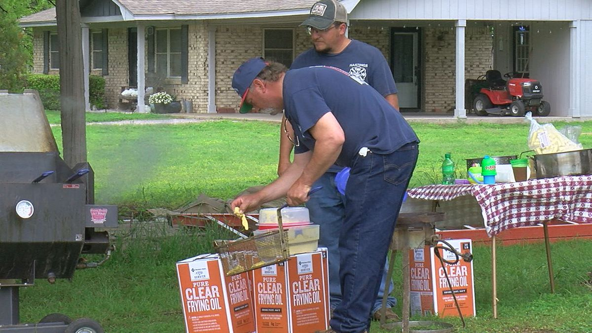 Firefighters on the Hastings Volunteer Fire Department cooking up fish, hush puppies, coleslaw,...