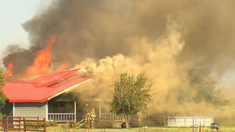 The flames were first reported around 9 a.m. Tuesday at Northeast 120th and Townley Road.